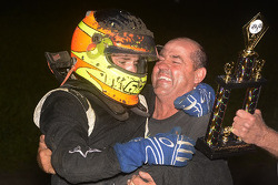 Isaac Schreurs celebrates in victory lane with his father