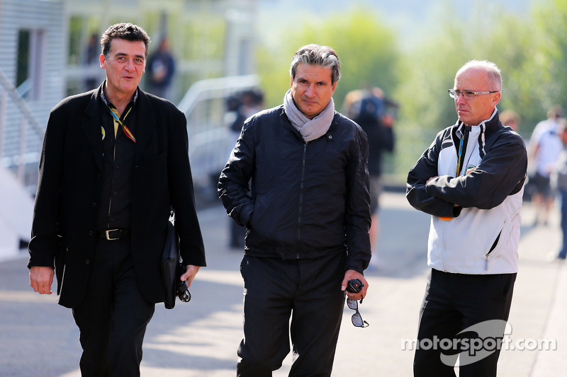 Federico Gastaldi, Lotus F1 Team Deputy Team Principal, and Pasquale Lattuneddu, of the FOM