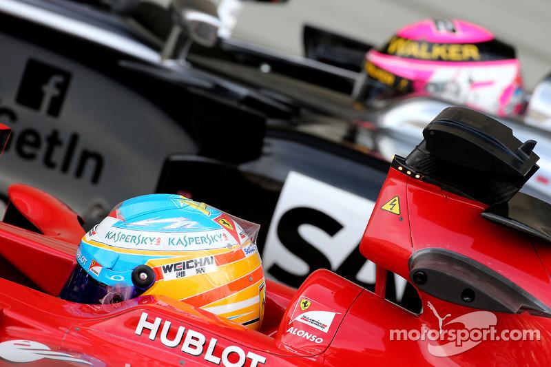 Fernando Alonso, Scuderia Ferrari and Jenson Button, McLaren F1 Team