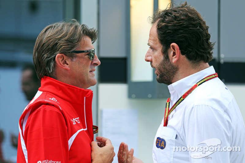 (L to R): Graeme Lowdon, Marussia F1 Team Chief Executive Officer with Matteo Bonciani, FIA Media Delegate