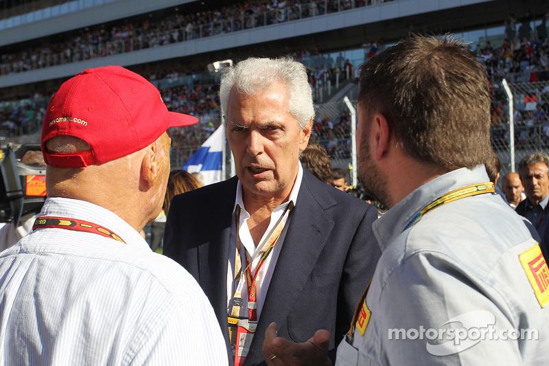 (L to R): Niki Lauda, Mercedes Non-Executive Chairman with Marco Tronchetti Provera, Pirelli Chairman and Paul Hembery, Pirelli Motorsport Director on the grid