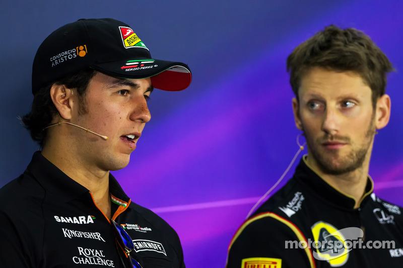 Sergio Pérez, Sahara Force India F1 con Romain Grosjean, Lotus F1 Team en la conferencia de prensa d