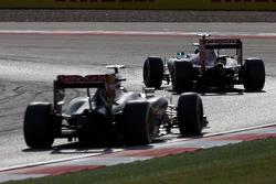 Jean-Eric Vergne, Scuderia Toro Rosso STR9 leads Romain Grosjean, Lotus F1 E22