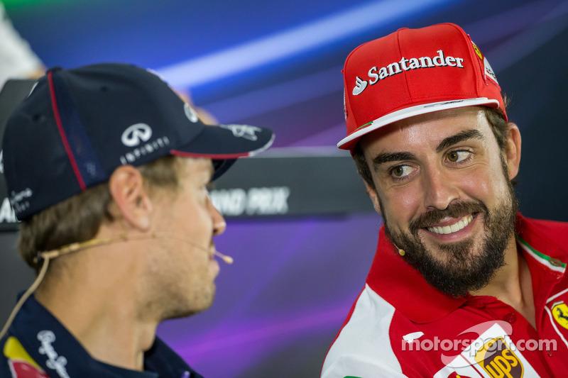 (L to R): Sebastian Vettel, Red Bull Racing with Fernando Alonso, Ferrari in the FIA Press Conferenc