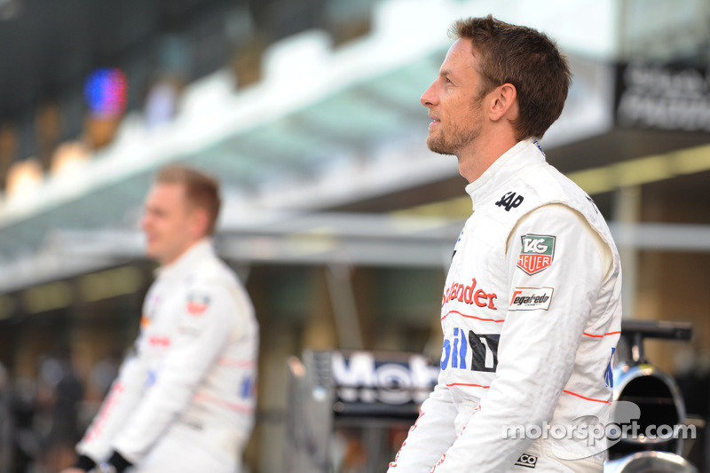 (L to R): Kevin Magnussen, McLaren and Jenson Button, McLaren at a team photograph