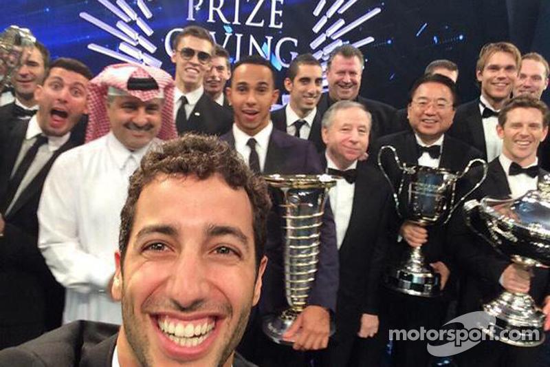 Daniel Ricciardo takes a selfie with Lewis Hamilton, Jean Todt and others