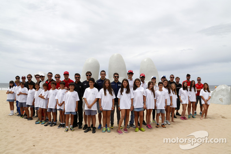 Drivers group photo on the beach