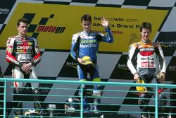 Podium: second place Randy De Puniet, Race winner Dani Pedrosa, third place Sebastián Porto