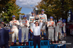 Podium: winners Markko Martin and Michael Park, with 2004 WRC champions Sébastien Loeb and Daniel Elena, and Carlos Sainz and Marc Marti
