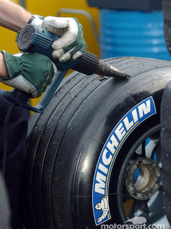 Michelin technician scrubs tires