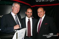 Sheikh Maktoum Hasher Maktoum Al Maktoum (UAE) CEO and President of A1 Grand Prix (centre) with two guests