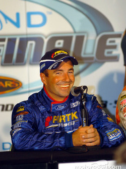 An excited Marcos Ambrose during the press conference