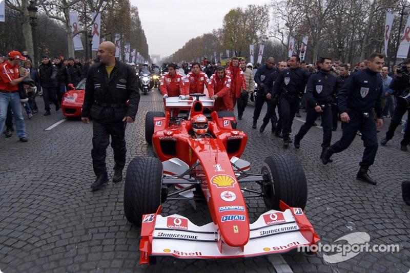 Parade on Champs-Elysées: Michael Schumacher drives his Ferrari F2004 F1 on the famous avenue in Paris