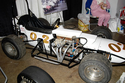 Crosley-powered 3/4 Midget.  Driven by Bob Dini, Tony Romit and Johnny Coy.  The offset engine put weight on the outside wheels for traction on slick indoor tracks.