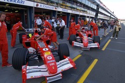 Michael Schumacher and Rubens Barrichello back in the pits