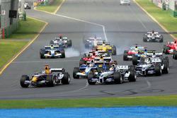First corner: David Coulthard battles with Mark Webber