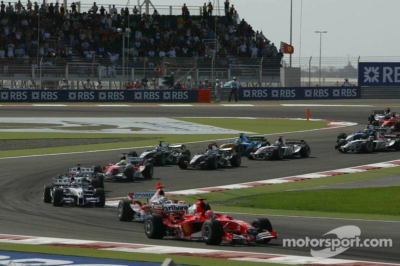Primera curva Michael Schumacher y Jarno Trulli