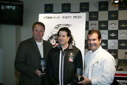 Indy Racing League President and COO Brian Barnhart, left, TAG Heuer Midwest Regional Sales Director Michael Ressler, center, and Indianapolis Motor Speedway President and COO Joie Chitwood