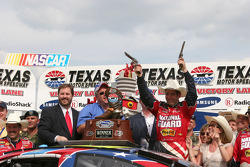 Victory lane: race winner Greg Biffle celebrates Texas style