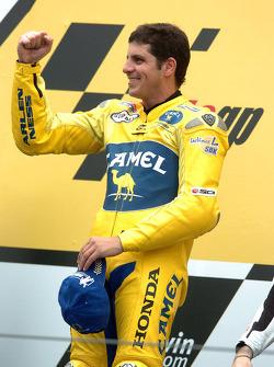 Podium: race winner Alex Barros celebrates