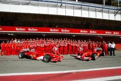 Ferrari photoshoot: Michael Schumacher and Rubens Barrichello pose with Ferrari team members