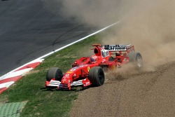 Michael Schumacher in trouble with a tire puncture