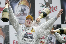 Podium: champagne shower Mika Hakkinen