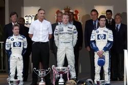 Podium : le vainqueur Kimi Räikkönen avec Nick Heidfeld et Mark Webber