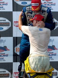 Podium: race winner Paul Tracy with A.J. Allmendinger