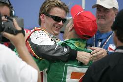 Victory lane: race winner Tony Kanaan celebrates with Dan Wheldon