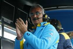 Flavio Briatore celebrates pole position