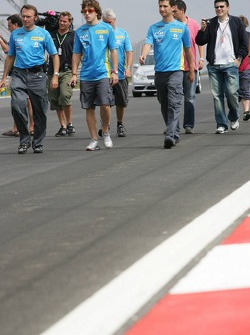 Fernando Alonso walks the track