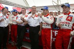 Winners Sébastien Loeb and Daniel Elena celebrate victory with Citroën Sport team members