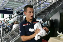 Christian Klien plays with a Sony Aibo robot dog