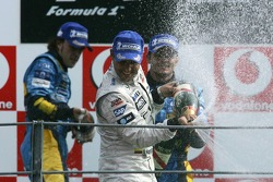 Podium: champagne for Juan Pablo Montoya, Fernando Alonso and Giancarlo Fisichella