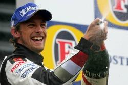 Podium: champagne for Jenson Button