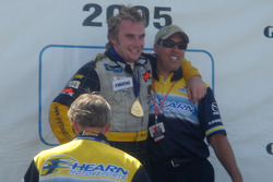 Podium: race winner Jay Howard celebrates with team boss Richie Hearn