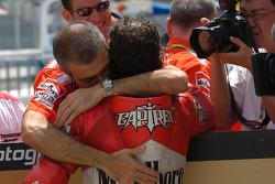 Pole winner Loris Capirossi celebrates