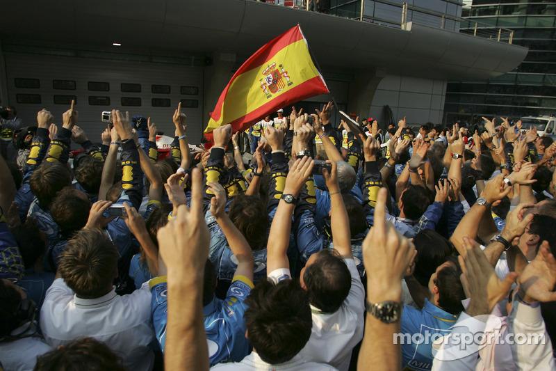 Renault F1 team members celebrate world championship during podium ceremony