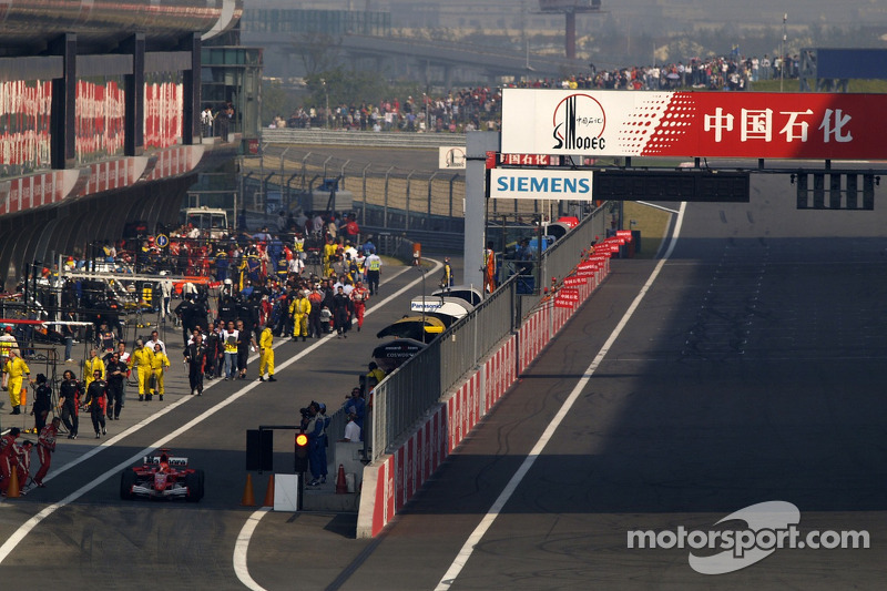 Michael Schumacher starts from the pitlane