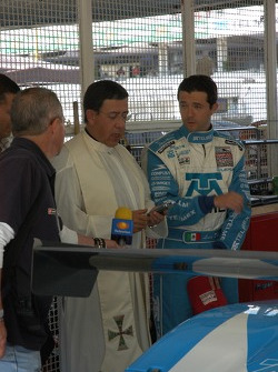 Priest blessing Luis Diaz' car