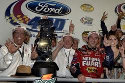 Victory lane: race winner Greg Biffle celebrates with Jack Roush and Edsel Ford IV