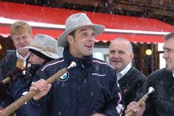 Jorg Muller blows an Alpine horn in the snow