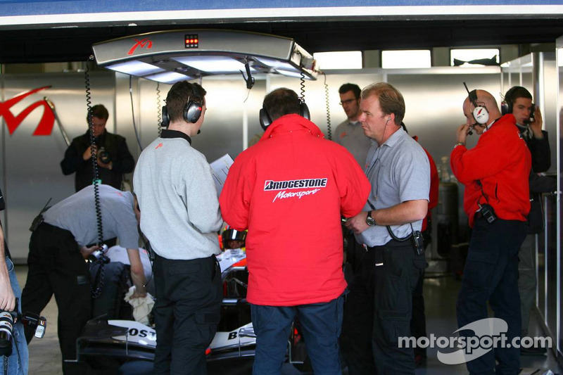 Bridgestone engineers in the MF1 Racing garage area