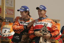 Bike category podium: winner Marc Coma celebrates with Giovanni Sala
