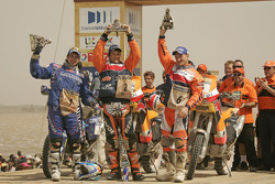 Bike category podium: winner Marc Coma celebrates with Cyril Despres and Giovanni Sala