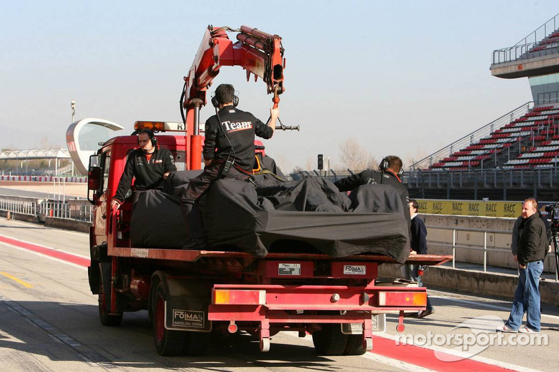The McLaren MP4-21 of Pedro de la Rosa back to the pits after stopping on the track