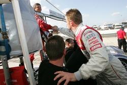 Pole winner Allan McNish celebrates with Audi team members