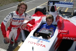 Jarno Trulli with a young driver