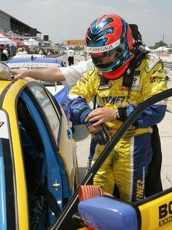 Race winner Bill Auberlen gets out of his car